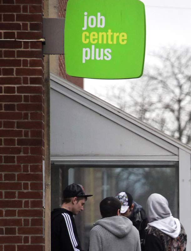 people-stand-outside-the-jobcentre-plus-507266858