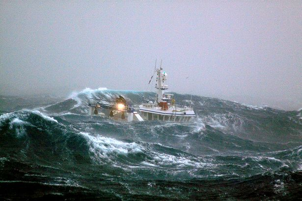 ONE USE ONLY - Fishing vessel -Harvester- crashing into wave on the North Sea, Europe, October 2011