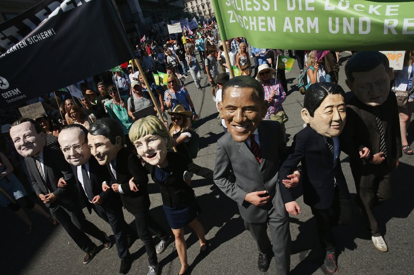 MUNICH, GERMANY - JUNE 04:  Activists wearing masks that look like the leaders of the G7 group of nations join a protest march against the upcoming G7 summit and attended by approximately 30,000 people on June 4, 2015 in Munich, Germany. The leaders of the G7 nations are scheduled to meet at nearby Schloss Elmau June 7-8.  (Photo by Sean Gallup/Getty Images)
