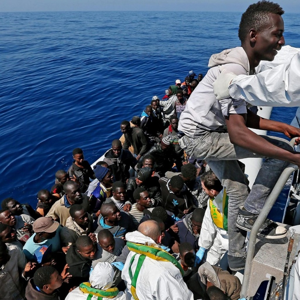 A picture made available on 23 April 2015 shows some of over 200 illegal migrants, as they are rescued and to be shipped to the Italian mainland by the Italian Coast Guard on April 22.