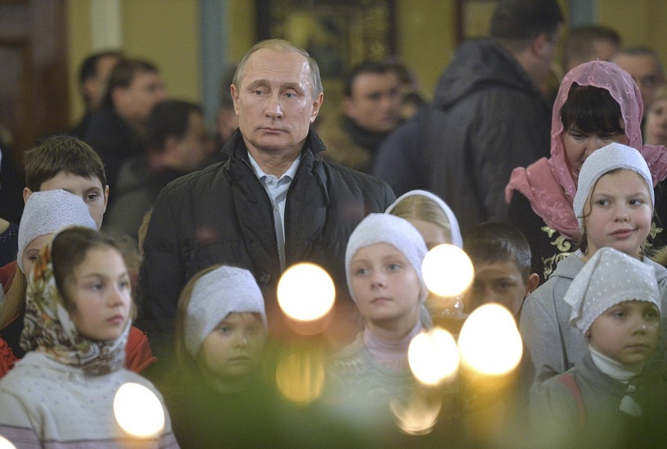 2FDB5BE800000578-3388083-Vladimir_Putin_attended_midnight_Mass_this_morning_celebrating_t-a-55_1452147465665